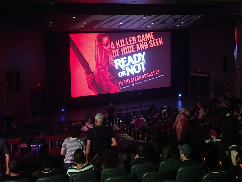 Attendees file in for a screening of Ready or Not (2019).